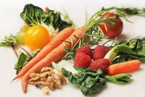 Carrots, walnuts, raspberries, tomatoes, and greens