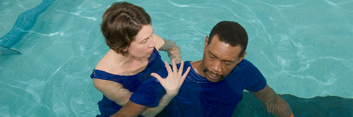 Patient participating in aquatic therapy with aquatic therapist