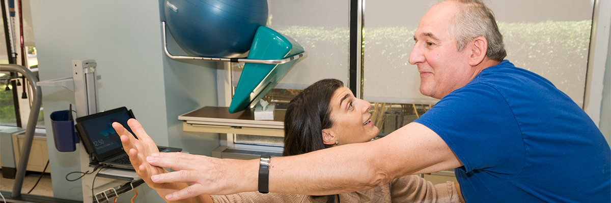 Occupational Therapist working with patient during orthopedic occupational therapy