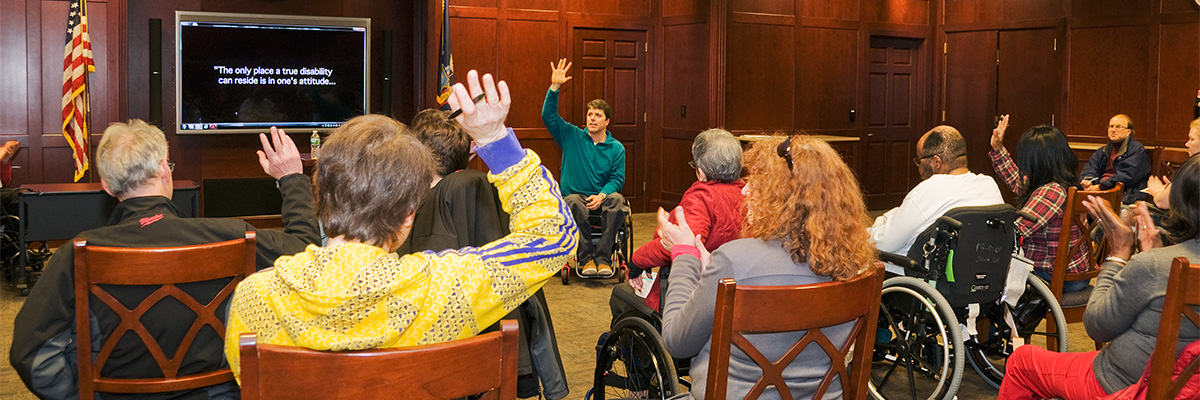 Speaker talking during a support group meeting at Helen Hayes Hospital
